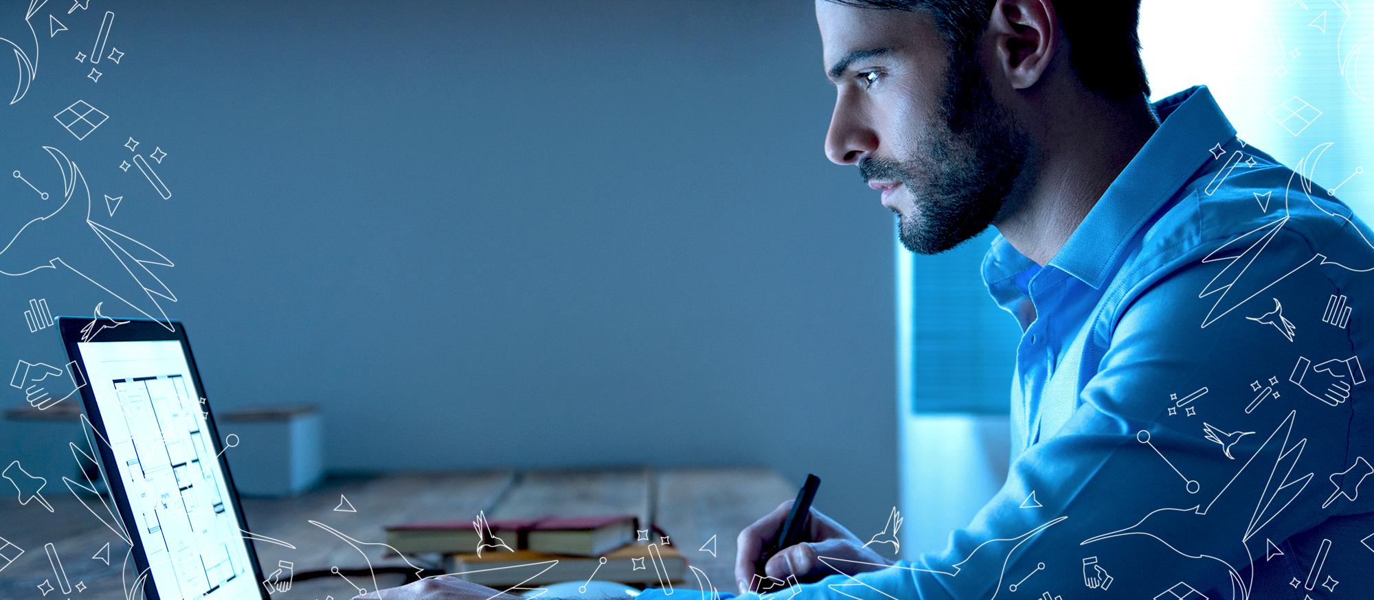 AutoCAD Courses: Man Using AutoCAD on Laptop